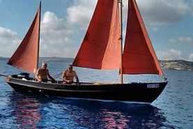 Drascombe Lugger Sailing Boat with deep blue water